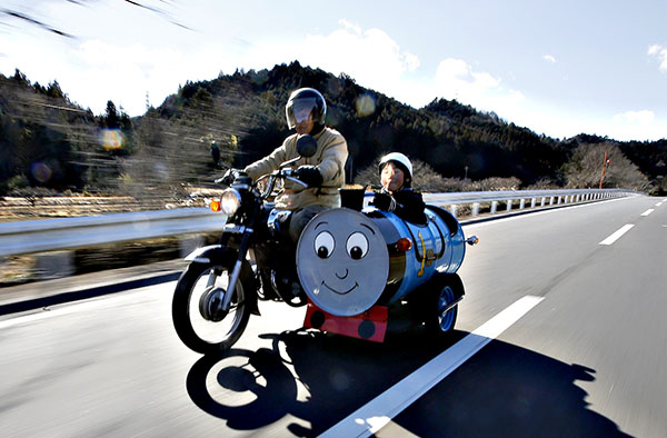 Sadao Kimbara rides on a Honda motorcycle with a sidecar he made out of an oil barrel as his grandson Rui smiles in the sidecar in Ome, outskirts of Tokyo...Sadao Kimbara (L) rides on a Honda motorcycle with a sidecar he made out of an oil barrel as his grandson Rui smiles in the sidecar in Ome, outskirts of Tokyo February 14, 2015. Saudi Arabia's oil exports have risen in February in response to stronger demand from customers. As OPEC's top producer battles for market share Reuters photographers around the globe have been photographing oil barrels to document how they are utilised once the fuel has been used. REUTERS/Toru Hanai (JAPAN - Tags: BUSINESS SOCIETY ENERGY TPX IMAGES OF THE DAY) ATTENTION EDITORS: PICTURE 01 OF 42 FOR WIDER IMAGE PACKAGE 'ROLL OUT THE BARRELS' TO FIND ALL IMAGES SEARCH 'OIL BARRELS'